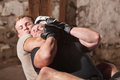 Man in Rear Choke Hold. European MMA athlete strangles opponent from behind stock photography
