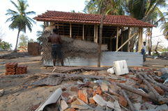 Man Rebuilding. May 18, 2005 - A man in Navalady, Sri Lanka, starts rebuilding his home with materials provided by an aid agency after the Asian tsunami Royalty Free Stock Image