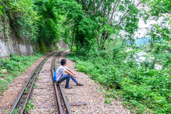 Man recapturing about the World War II at Death Railway, Kanchanaburi Thailand Stock Photography