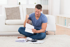 Man With Receipts And Calculator Stock Images