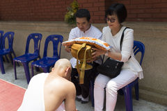 Man receive monk robe from their parent in buddhist monk ordinat Stock Image