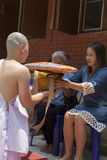 Man receive monk robe from their parent in buddhist monk ordinat Stock Photography