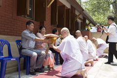 Man receive monk robe from their parent in buddhist monk ordinat Stock Photos