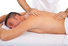Man receive torso massage stock photos