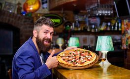 Man received delicious pizza. Enjoy your meal. Cheat meal concept. Pizza favorite restaurant food. Fresh hot pizza for. Dinner. Hipster hungry eat italian pizza royalty free stock images
