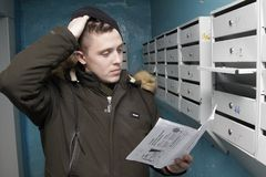 Man got bills in the mailbox stock image