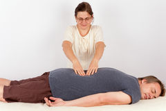 Man receives Bowen therapy similar to back massage. The Man receives Bowen therapy similar to back massage stock images