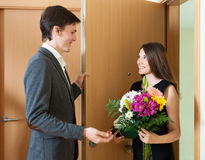 Man receives a gift from a girl Royalty Free Stock Image