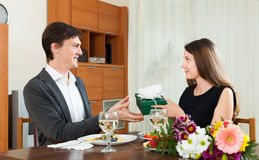 Man receives a gift from the girls Stock Images