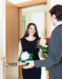 Man receives a gift from a woman Stock Photography