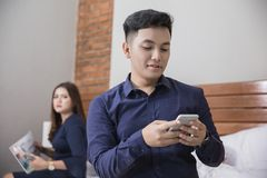 Two couple busy using gadget. cheating concept Stock Photo