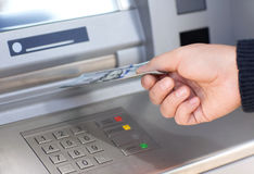 Man receives money from ATM Royalty Free Stock Photos