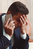 Man receiving bad news on the phone Royalty Free Stock Image