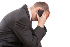 Man receiving bad news. Man talking on the telephone and receiving bad news Stock Photo