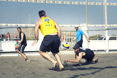 Man receiving the ball. Beach volleyball Stock Photos