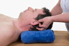 Man receiving a facial and ears massage Royalty Free Stock Images