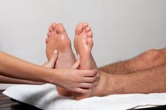 Man Receiving a Foot Massage Stock Images
