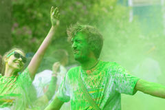 Man receiving green color powder and happy girl Stock Photos