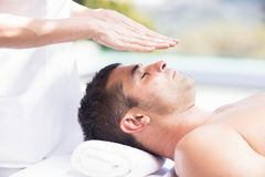 Man receiving a head massage from masseur Royalty Free Stock Photo
