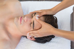Man receiving head massage at spa center Royalty Free Stock Photography