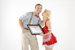 Man receiving kiss and certificate from woman. stock image