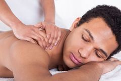 Man receiving massage from female hand stock photography