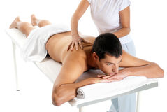 Man receiving massage relax treatment. From female hands Royalty Free Stock Photography