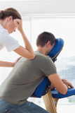 Man receiving massage from therapist Royalty Free Stock Images