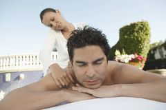Man Receiving Message From A Masseur Royalty Free Stock Photography