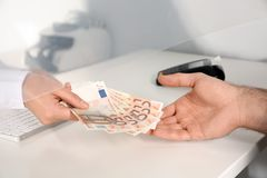 Man receiving money from teller at cash. Department window, closeup stock photography