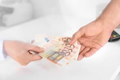 Man receiving money from teller at cash department. Window, closeup royalty free stock image