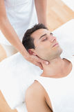 Man receiving neck massage. In medical office stock images