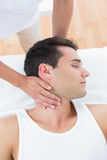 Man receiving neck massage Royalty Free Stock Image