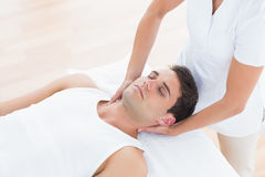 Man receiving neck massage. In medical office royalty free stock photos