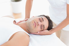 Man receiving neck massage. In medical office royalty free stock photo