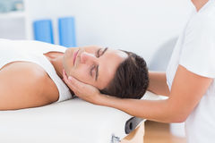 Man receiving neck massage. In medical office stock photo