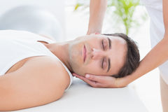 Man receiving neck massage. In medical office stock photography