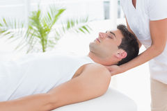 Man receiving neck massage. In medical office stock photos