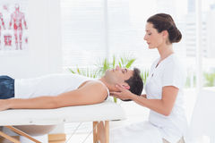 Man receiving neck massage. In medical office royalty free stock image