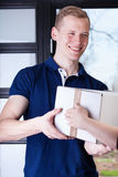 Man receiving a package Royalty Free Stock Images