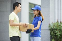 Man receiving parcel royalty free stock photography