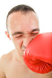Man receiving punch shock with a boxing glove in the face Royalty Free Stock Photo