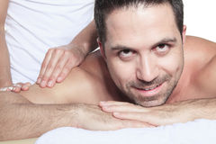 Man receiving Shiatsu massage from a professional Royalty Free Stock Photos