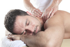 Man receiving Shiatsu massage from a professional. A Man receiving Shiatsu massage from a professional masseur at spa salon royalty free stock images