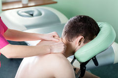 Man receiving shoulder massage Stock Photos