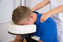 Man receiving shoulder massage Stock Images