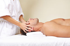 Man receiving thai massage in day Stock Photo