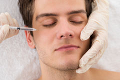 Man Receiving Wrinkle Treatment Stock Photography
