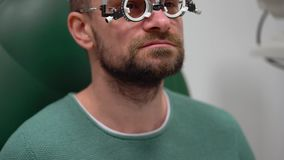 Man at the reception of an ophthalmologist. Eye examination and selection of spectacle lenses