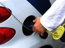 A man recharge his car Royalty Free Stock Photos